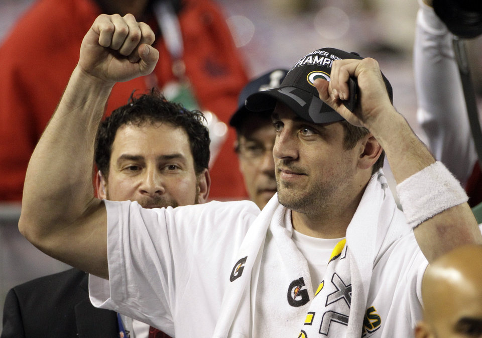 Photo - Green Bay Packers quarterback Aaron Rodgers celebrates after the Packers beat the Pittsburgh Steelers 31-25 in the NFL Super Bowl XLV football game Sunday, Feb. 6, 2011, in Arlington, Texas. (AP Photo/Patrick Semansky)