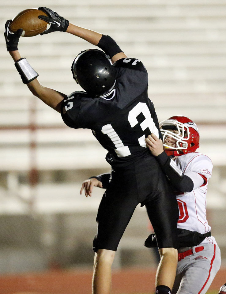 Photo - Zach Rayner (13) catches a touchdown pass for Pond Creek-Hunter as Taylor Townsend (15) defends for Fox during a Class B semifinal high school football playoff game between Pond Creek-Hunter and Fox in Del City, Friday, Nov. 23, 2012. Photo by Nate Billings, The Oklahoman