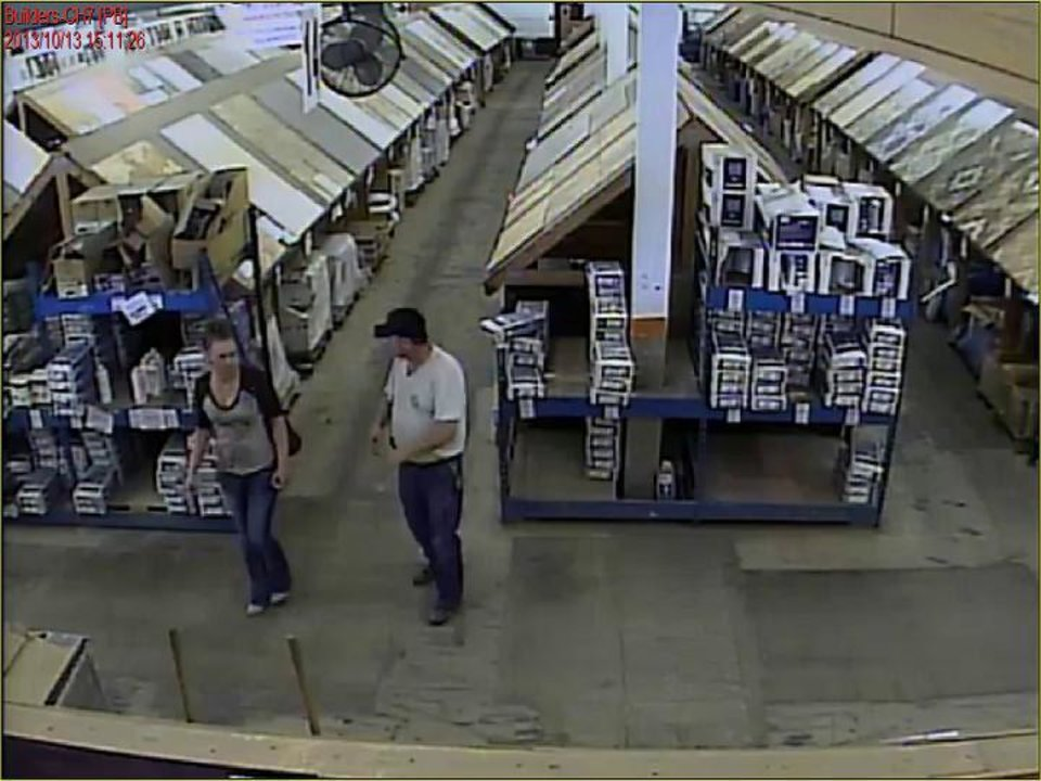 Photo - The woman wanted for questioning is show walking around the store where the fraudulent check was used. PHoto courtesy of the Oklahoma City Police Department