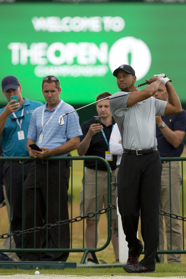 Photo - Tiger Woods of the US plays a shot off the 3rd tee during a practice round at the Royal Liverpool Golf Club prior to the start of the British Open Golf Championship, in Hoylake, England, Saturday, July 12, 2014. The 2014 Open Championship starts on Thursday, July 17. (AP Photo/Jon Super)
