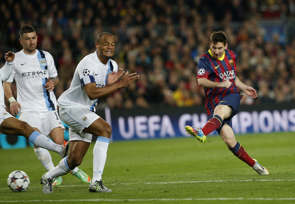 Photo - Barcelona's Lionel Messi, right shoots on goal during a Champions League, round of 16, second leg, soccer match between FC Barcelona and Manchester City at the Camp Nou Stadium in Barcelona, Spain, Wednesday March 12, 2014. (AP Photo/Emilio Morenatti)