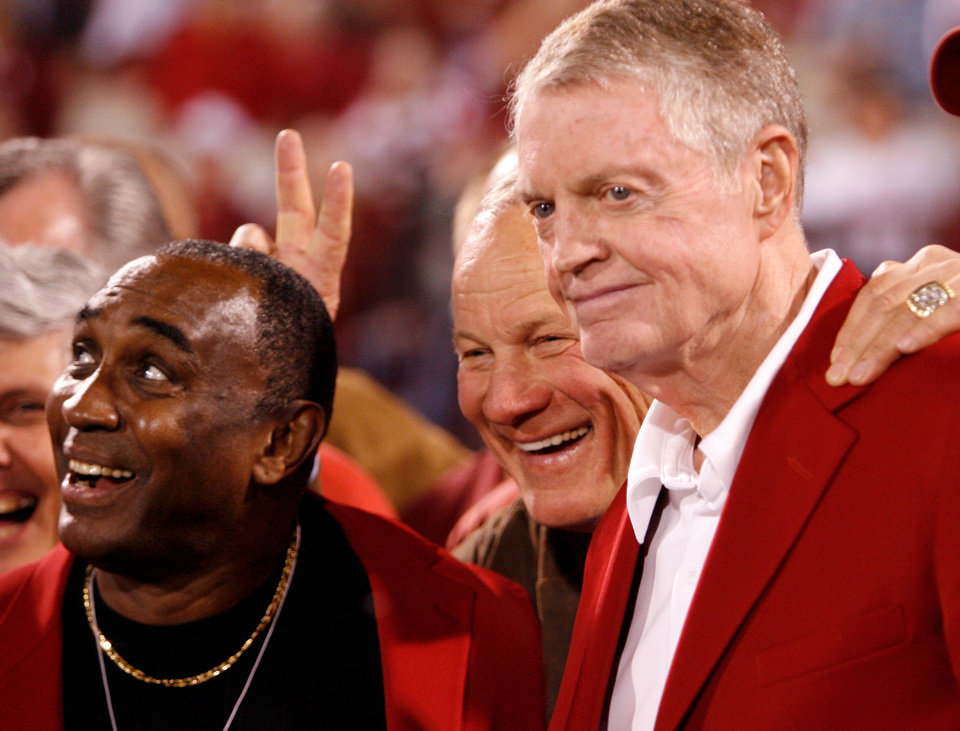 Photo - 1971 GAME OF THE CENTURY REUNION: Johnny Rodgers, Barry Switzer and Tom Osborne pose for a group photograph at the half of the college football game between the University of Oklahoma Sooners (OU) and the University of Nebraska Huskers (NU) at the Gaylord Family -- Oklahoma Memorial Stadium, on Saturday, Nov. 1, 2008, in Norman, Okla.   BY STEVE SISNEY, THE OKLAHOMAN  ORG XMIT: KOD  STEVE SISNEY - THE OKLAHOMAN