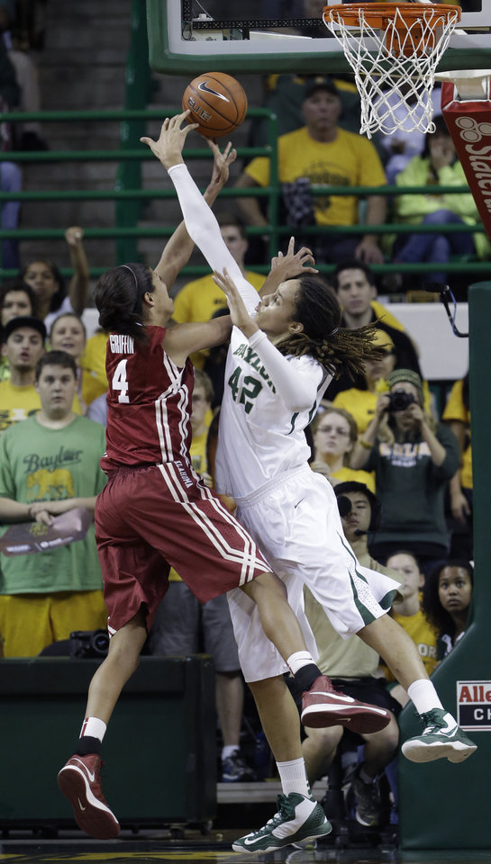 Photo - Oklahoma's Nicole Griffin (4) is fouled by Baylor's Brittney Griner (42) during the second half of an NCAA college basketball game Saturday, Jan. 26, 2013, in Waco Texas.  Baylor won 82-65. (AP Photo/LM Otero) ORG XMIT: TXMO115