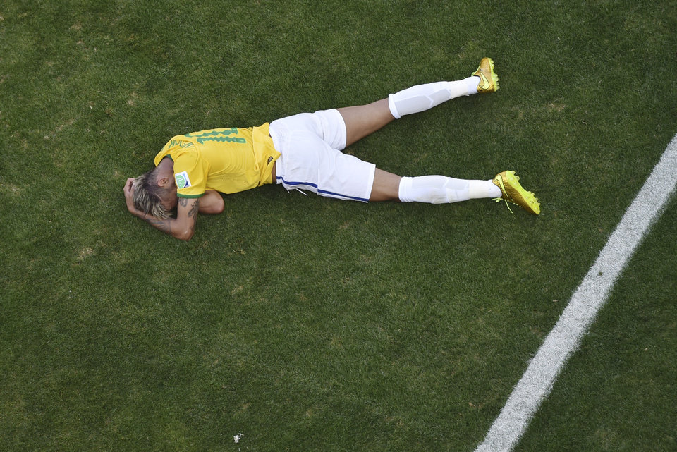 Photo - Brazil's Neymar sits on the pitch during the World Cup round of 16 soccer match between Brazil and Chile at the Mineirao Stadium in Belo Horizonte, Brazil, Saturday, June 28, 2014. (AP Photo/Francois Xavier Marit, pool)