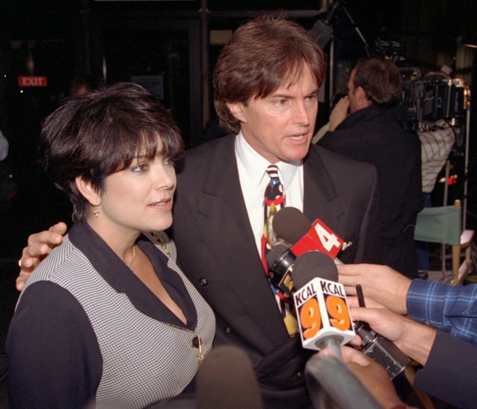Photo - FILE - This Sept. 27, 1995 file photo shows Olympic gold medal champion Bruce Jenner and his wife Kris Jenner with the media at the Criminal Courts Building as they arrive for closing arguments in the O.J. Simpson double-murder trial in Los Angeles. The celebrity couple have confirmed they separated a year ago, after 22 years together.  (AP Photo/Nick Ut, File)