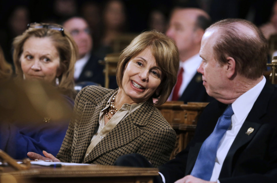 Photo - New Jersey state Sen. Barbara Buono, center, D-Edison, talks with Assemblyman Patrick J. Diegnan, D-South Plainfield, as Gov. Chris Christie delivers his State Of The State address Tuesday, Jan. 8, 2013, in Trenton, N.J. Buono has announced that she will challenge the first-term Republican governor in November. (AP Photo/Mel Evans)