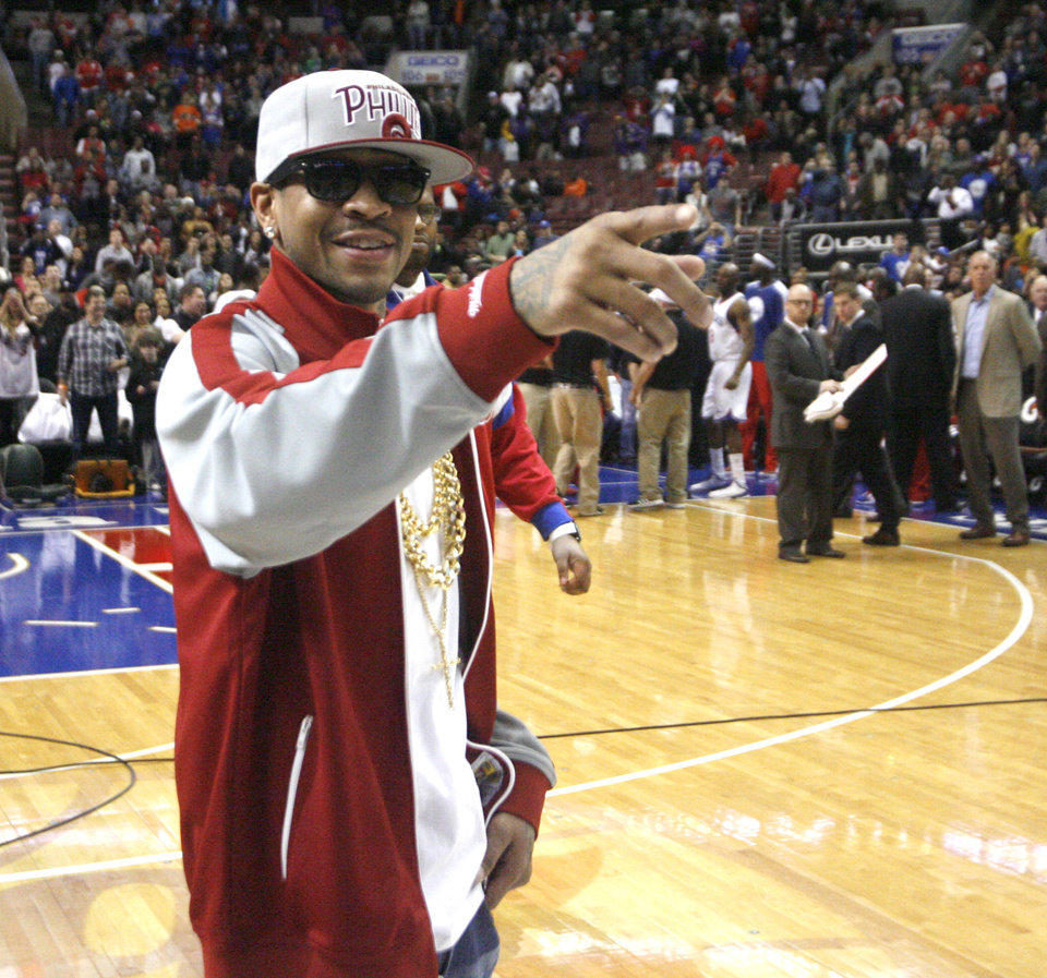 Former Philadelphia 76ers guard Allen Iverson is introduced to the crowd before the start of the Charlotte Bobcats and Philadelphia 76ers NBA basketball game, Saturday, March 30, 2013, in Philadelphia. Iverson was honored with a bobblehead giveaway. The bobblehead was made in his likeness (AP Photo/H. Rumph Jr)