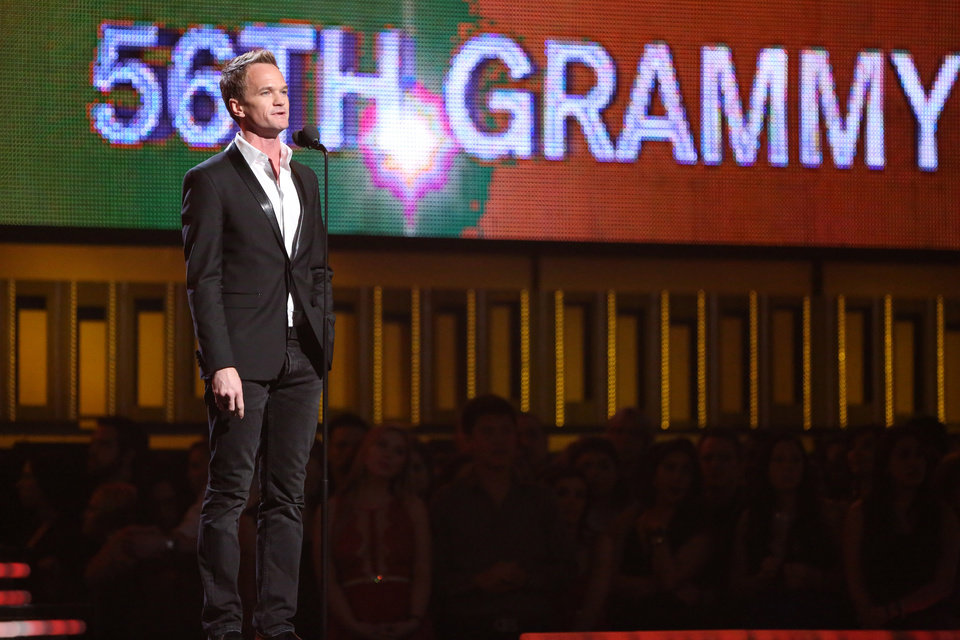 Photo - Neil Patrick Harris introduces a performance by Pharrell Williams, Daft Punk and Stevie Wonder, at the 56th annual Grammy Awards at Staples Center on Sunday, Jan. 26, 2014, in Los Angeles. (Photo by Matt Sayles/Invision/AP)