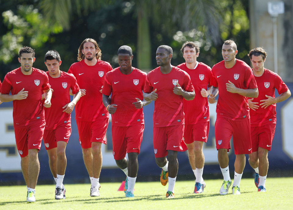 Photo -   U.S. men's national soccer team members warm up during a workout, Tuesday, Oct. 9, 2012 on the campus of Florida International University in Miami. The U.S. plays at Antigua and Barbuda on Friday Oct. 12, and in Kansas City against Guatemala on Oct. 16, in two World Cup qualifying matches. (AP Photo/Wilfredo Lee)