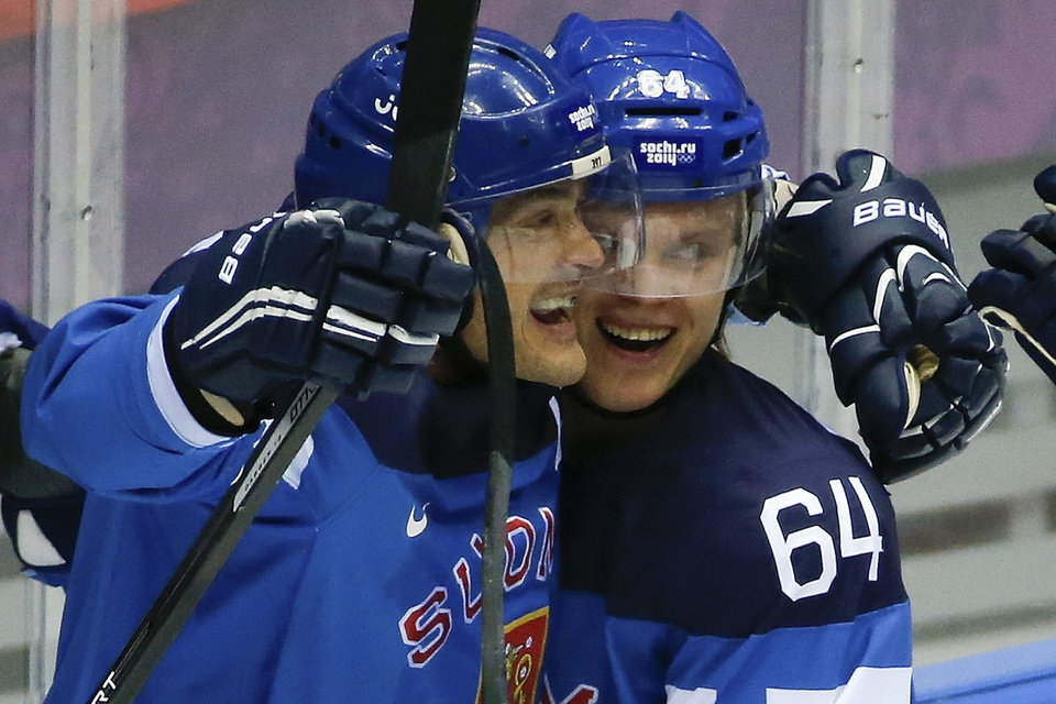 Photo - Finland forward Teemu Selanne and Finland forward Mikael Grandlund celebrate a second period goal against Russia during a men's quarterfinal ice hockey game at the 2014 Winter Olympics, Wednesday, Feb. 19, 2014, in Sochi, Russia. (AP Photo/Mark Humphrey)