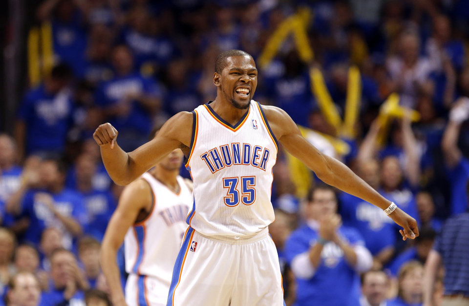 Photo - Oklahoma City's Kevin Durant (35) celebrates during Game 1 in the first round of the NBA playoffs between the Oklahoma City Thunder and the Houston Rockets at Chesapeake Energy Arena in Oklahoma City, Sunday, April 21, 2013. Photo by Sarah Phipps, The Oklahoman