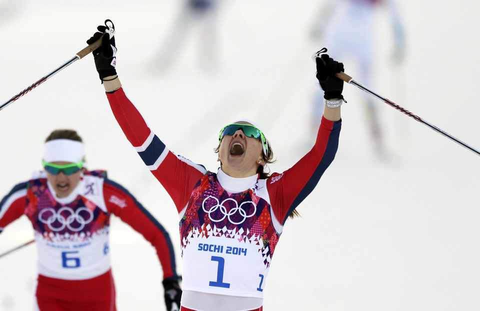 Photo - Norway's Maiken Caspersen Falla crosses the finish line to win gold in the final of the women's cross-country sprint at the 2014 Winter Olympics, Tuesday, Feb. 11, 2014, in Krasnaya Polyana, Russia. (AP Photo/Matthias Schrader, File)