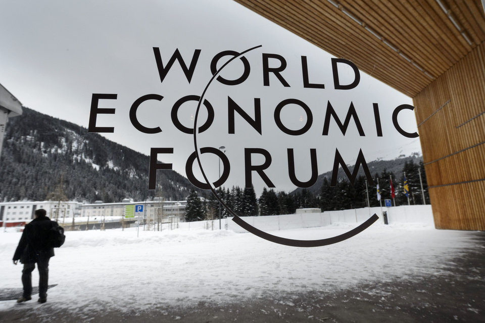 A man walks outside the main entrance of the Congress Center, on the eve of the opening of the 43rd Annual Meeting of the World Economic Forum, WEF, in Davos, Switzerland, Tuesday, Jan. 22, 2013. The overarching theme of the meeting, which will take place from 23 to 27 January, is