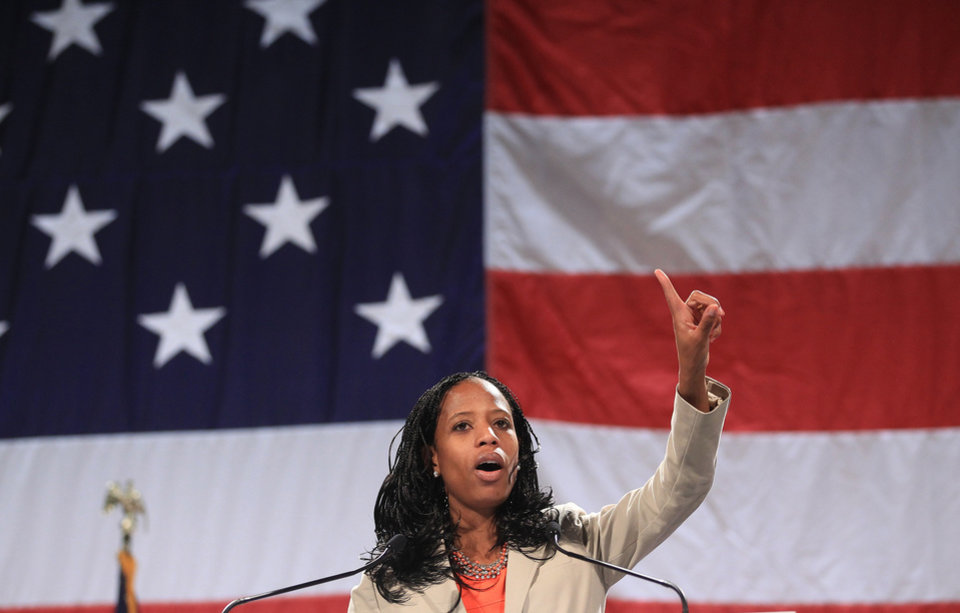 Photo - Republican congressional candidate Mia Love addresses a rally during the Western Republican Leadership Conference, Friday, April 25, 2014, in Sandy, Utah. Republican U.S. Sen. Ted Cruz, of Texas, is scheduled to headline the final day of a two-day conference in Utah where Republican party leaders from western states are meeting. (AP Photo/Rick Bowmer)