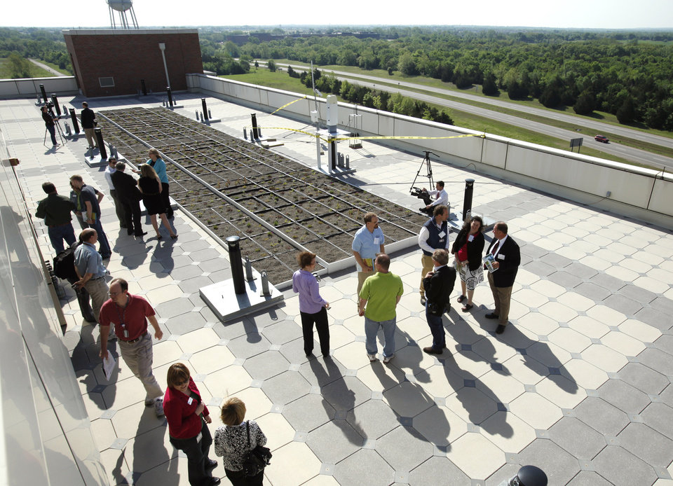 Photo - OU: Visitors attend an open house for the vegetative roof system atop the National Weather Center at the University of Oklahoma campus on Thursday, April 22, 2010, in Norman, Okla.  The green roof -- literally and figuratively -- is the first of its kind at a university.  Photo by Steve Sisney, The Oklahoman ORG XMIT: KOD