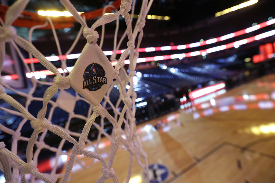Photo -  An NBA All-Star logo is affixed to the net as workers prepare the Smoothie King Center for the NBA All-Star events, which run through the end of the week in New Orleans, Thursday, Feb. 13, 2014. (AP Photo/Gerald Herbert)