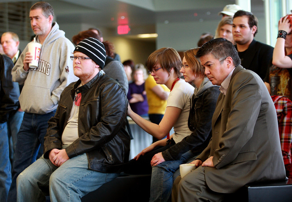 Photo - Students and staff listen to a news conference after an apparent murder-suicide on campus Friday, Nov. 30, 2012 at Casper College in Casper, Wyo. Police say a male suspect killed two people with an edged weapon before killing himself in a classroom at the college where students were present.  Police found two of those killed at a science building on the Casper College campus and the third at another location about 2 miles away. Authorities didn't identify the suspect or victims but said two were male and one was female. The suspect wasn't believed to be a student, but it appeared there was a relationship between the suspect and victims killed, Police Chief Chris Walsh said.  (AP Photo/The Casper Star-Tribune, Alan Rogers)  MANDATORY CREDIT  TRIB.COM