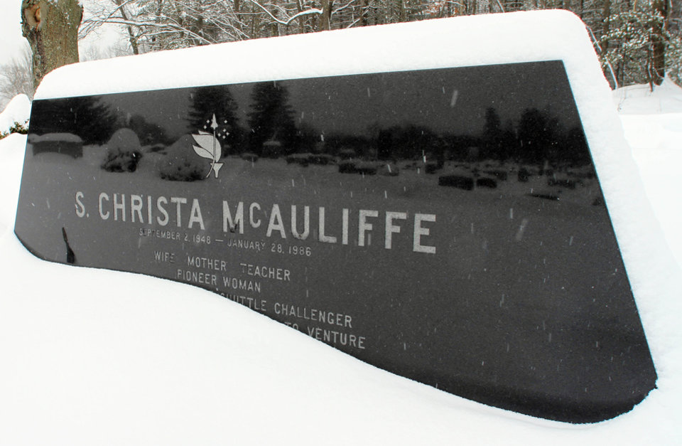 Photo - Snow falls on the gravesite of high school teacher Christa McAuliffe in this 2011 photo in Concord, N.H. McAuliffe and the rest of the crew of the space shuttle Challenger died when the shuttle exploded. Before the world knew her as