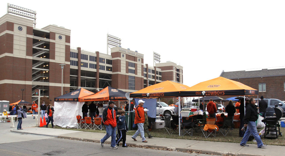 Photo -  Fans participate in tailgating activities before an Oklahoma State University football game at Boone Pickens Stadium. Photo by Doug Hoke, The Oklahoman Archives     DOUG HOKE -  THE OKLAHOMAN