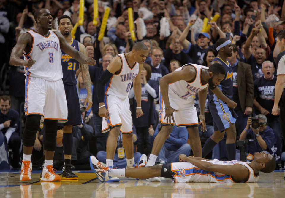 Photo - Oklahoma City's Kendrick Perkins (5), Russell Westbrook (0), Kevin Durant (35), and  James Harden (13) celebrate after Durant was fouled while making a basket during the NBA basketball game between the Denver Nuggets and the Oklahoma City Thunder in the first round of the NBA playoffs at the Oklahoma City Arena, Wednesday, April 27, 2011. Photo by Bryan Terry, The Oklahoman