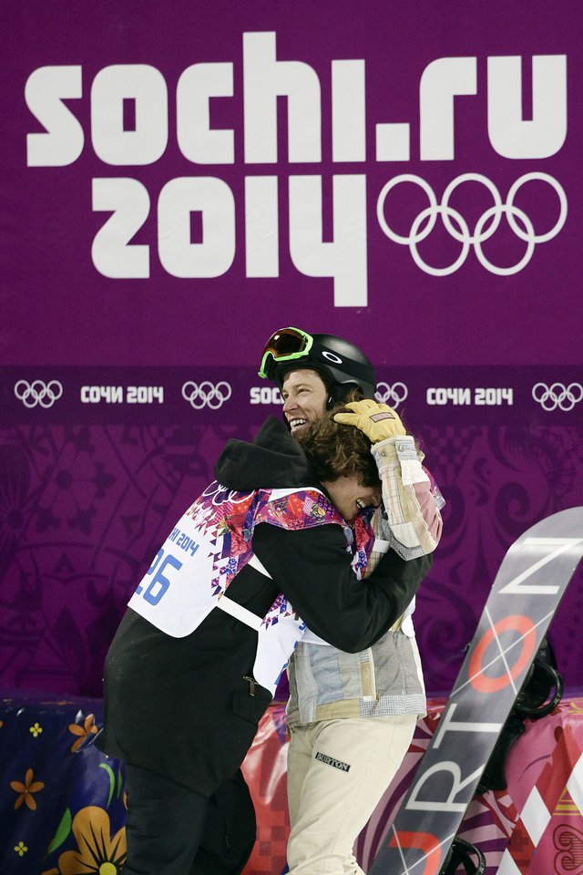 Photo - Switzerland's Iouri Podladtchikov, left, celebrates with Shaun White, of the United States, after Podladtchikov won the gold medal in the men's snowboard halfpipe final at the Rosa Khutor Extreme Park, at the 2014 Winter Olympics, Tuesday, Feb. 11, 2014, in Krasnaya Polyana, Russia. (AP Photo/Jae C. Hong, File)