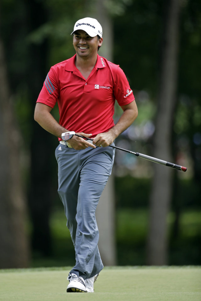 Photo - Jason Day, of Australia, smiles has he walks off the second green during the third round of the PGA Championship golf tournament at Valhalla Golf Club on Saturday, Aug. 9, 2014, in Louisville, Ky. (AP Photo/Jeff Roberson)