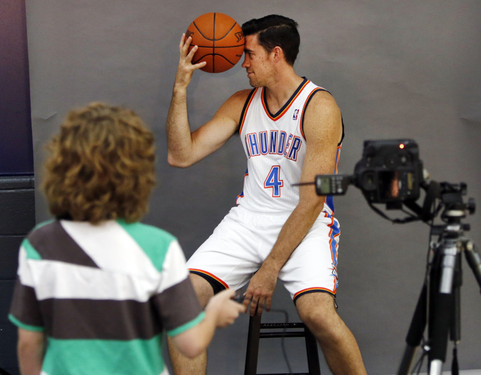 Tabius Landsberger, 11, takes a photo of Nick Collison during media day with the Oklahoma City Thunder in Oklahoma City, Thursday September  27, 2013. Photo By Steve Gooch, The Oklahoman