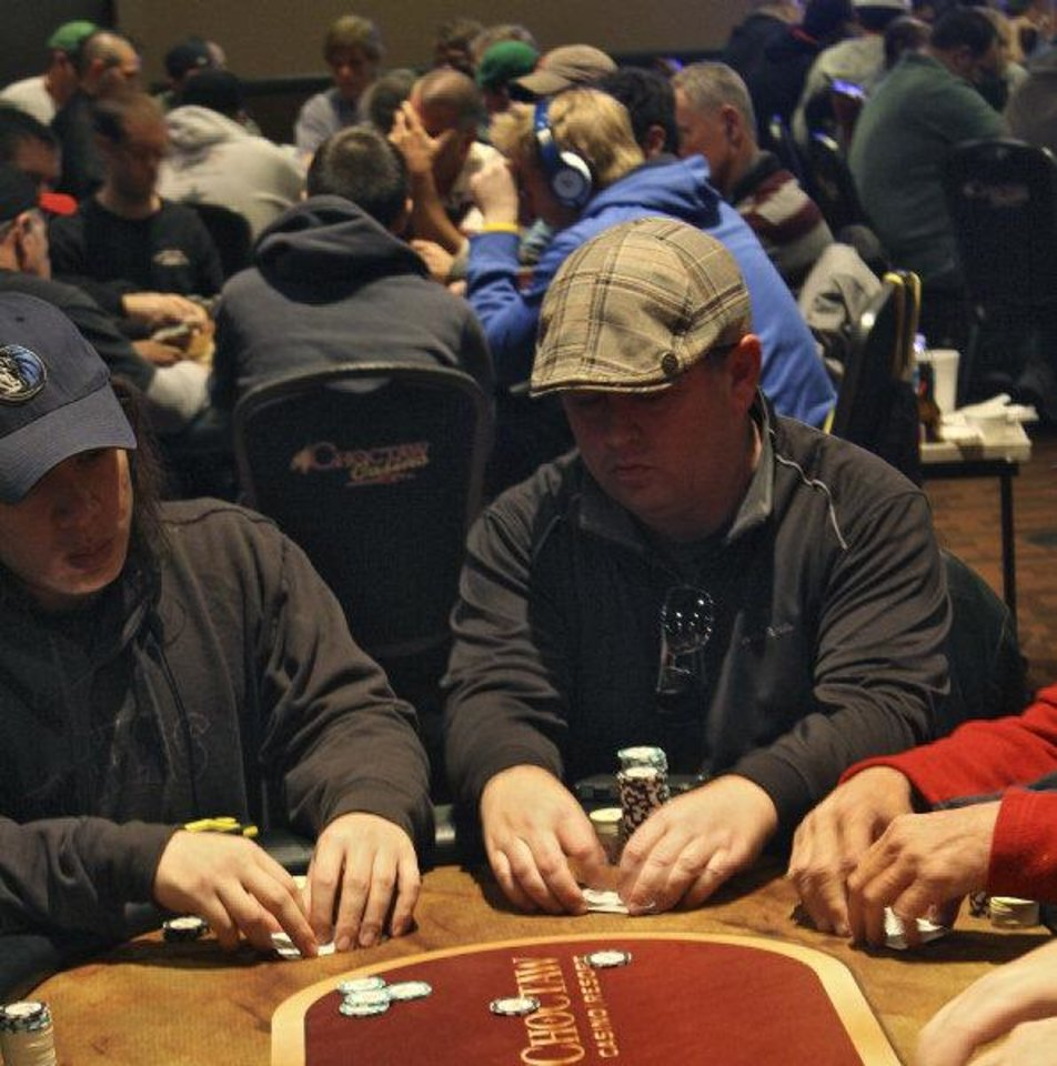 Photo - Players compete at the Choctaw Casino in Durant for the Native American Casino Poker Tour.  Photo by Sean Chaffin