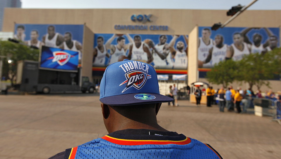 Thunder fan Adolph Rambo sits outside the Oklahoma City Arena during the fan fest before the start of the first round NBA playoff game between the Oklahoma City Thunder and the Denver Nuggets on Sunday, April 17, 2011, in Oklahoma City, Okla. Photo by Chris Landsberger, The Oklahoman