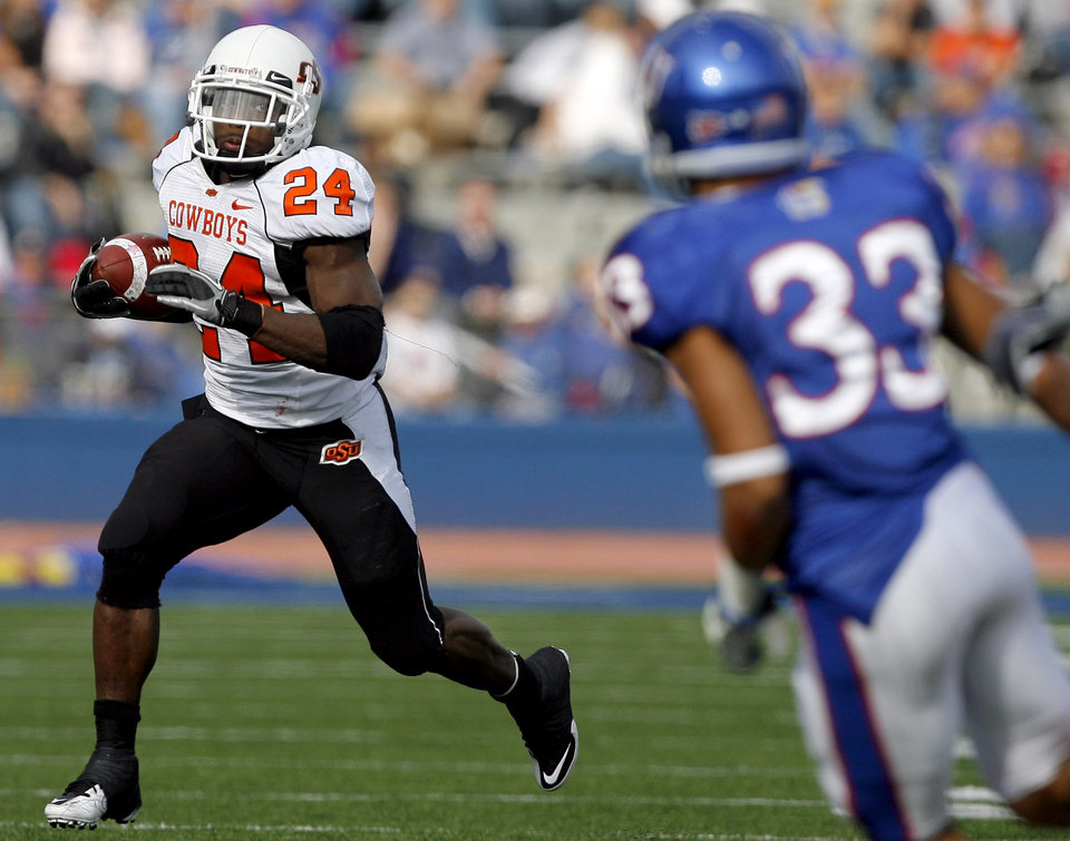 Photo - Oklahoma State's Kendall Hunter (24) looks to get past Kansas' *Tyler Patmon (33)during the college football game between Oklahoma State (OSU) and Kansas (KU), Saturday, Nov. 20, 2010 at Memorial Stadium in Lawrence, Kan. Photo by Sarah Phipps, The Oklahoman