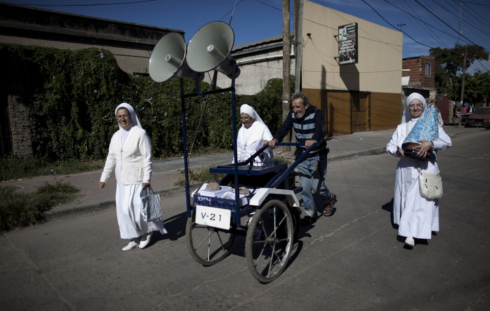 Photo - Nuns walk promoting the church's activities in the Villa 21-24 slum in Buenos Aires, Argentina, Sunday, March 17, 2013. Argentina's former cardinal Jorge Mario Bergoglio was chosen as leader of the Catholic Church on March 13, 2013, making him the New World's first pope. (AP Photo/Natacha Pisarenko)