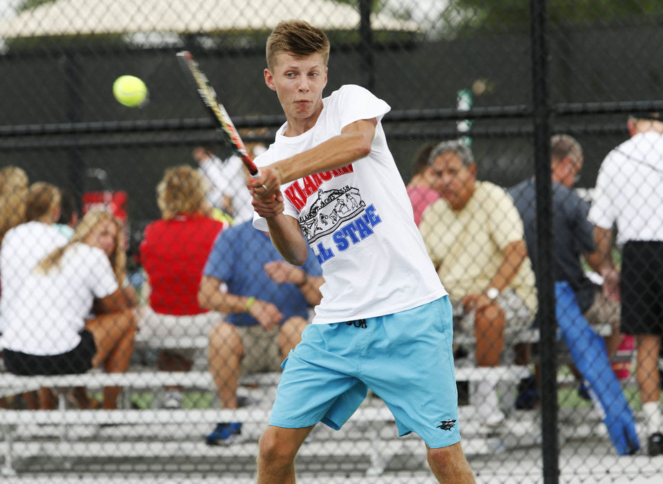 Union's Andreas Kutt competes with Jenk's Chase Gordon against a west team during the All-State tennis games at Union Intermediate High School in Tulsa, Okla., taken on July 30,2013. JAMES GIBBARD/Tulsa World