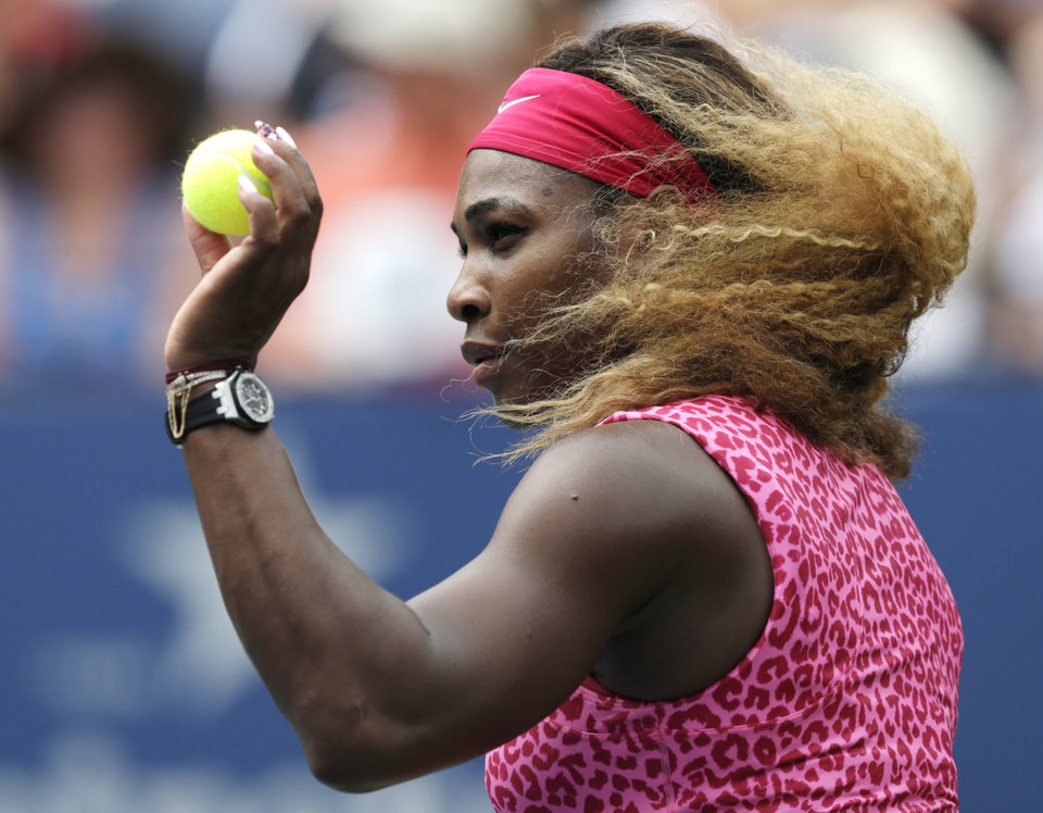 Photo - Serena Williams, of the United States, prepares to serve against Kaia Kanepi, of Estonia, during the fourth round of the 2014 U.S. Open tennis tournament, Monday, Sept. 1, 2014, in New York. (AP Photo/Charles Krupa)
