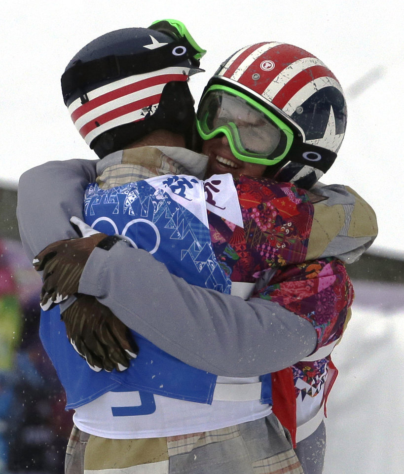 Photo - Alex Deibold of the United States, left, embraces Trevor Jacob of the United States after the men's snowboard cross semifinal at the Rosa Khutor Extreme Park, at the 2014 Winter Olympics, Tuesday, Feb. 18, 2014, in Krasnaya Polyana, Russia. (AP Photo/Andy Wong)