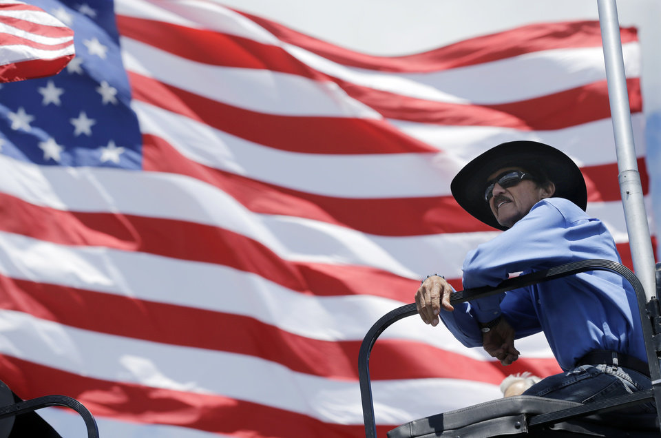 Photo - Car owner and former racing great, Richard Petty watches practice for Sunday's NASCAR Sprint Cup Series auto race, Friday Aug. 2, 2013, in Long Pond, Pa. (AP Photo/Mel Evans)