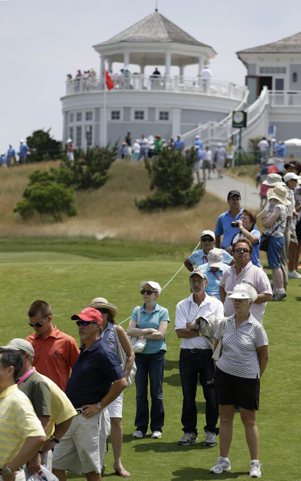 Photo - Fans watch action on the ninth hole during the first round at the U.S. Women's Open golf tournament at Sebonack Golf Club in Southampton, N.Y., Thursday, June 27, 2013.   (AP Photo/Seth Wenig)