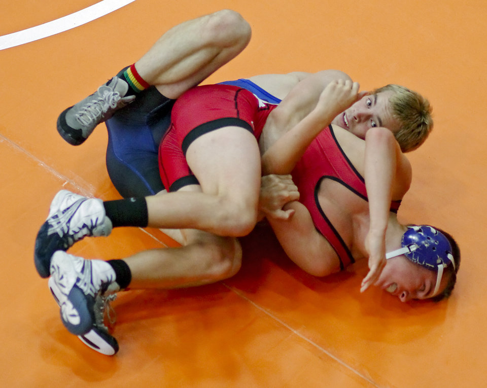 Grant Jongerius, of Kansas, top, takes on Peyton Reese, of Indiana, in the 126-pound match during the Junior National Duals at Oklahoma City University in Oklahoma City, Okla. Wednesday, June 27, 2012.   Photo by Chris Landsberger, The Oklahoman