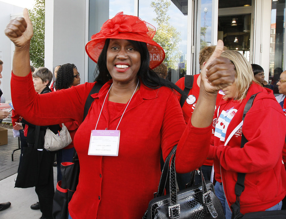 Photo -   Mary Edmonds, a member of the Chicago Teachers Union's House of Delegates, celebrates after the delegates voted to suspend the strike against the school district Tuesday, Sept. 18, 2012, in Chicago. The city's teachers agreed to return to the classroom after more than a week on the picket lines, ending a spiteful stalemate with Mayor Rahm Emanuel that put teacher evaluations and job security at the center of a national debate about the future of public education. (AP Photo/Charles Rex Arbogast)
