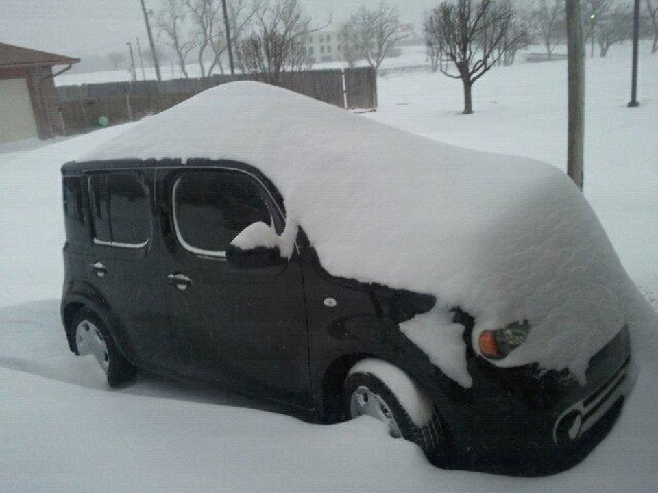 Photo - A snowed-in car in Midwest City. This is mostly drift.