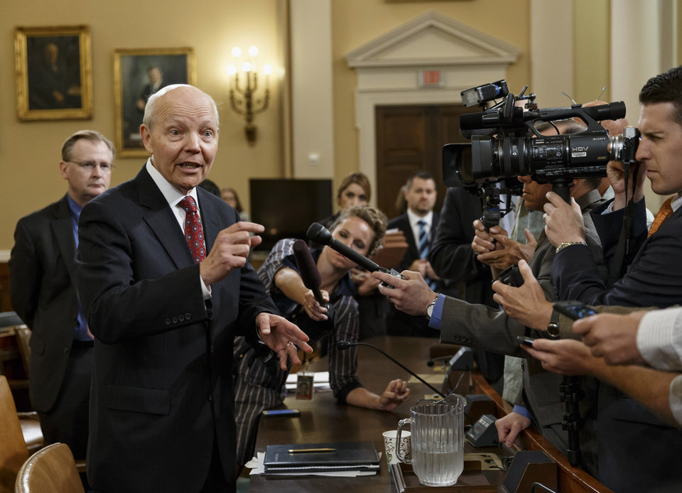 Photo - Internal Revenue Service Commissioner John Koskinen talks to reporters during a break in his appearance before the House Ways and Means Committee hearing on their continuing probe of whether tea party groups were improperly targeted for increased scrutiny by the IRS, Friday, June 20, 2014, on Capitol Hill in Washington. The IRS asserts it can't produce emails from seven officials connected to the tea party investigation because of computer crashes, including the emails from Lois Lerner, the former IRS official at the center of the investigation who has invoked her Fifth Amendment right at least nine times to avoid answering lawmakers' questions. (AP Photo/J. Scott Applewhite)