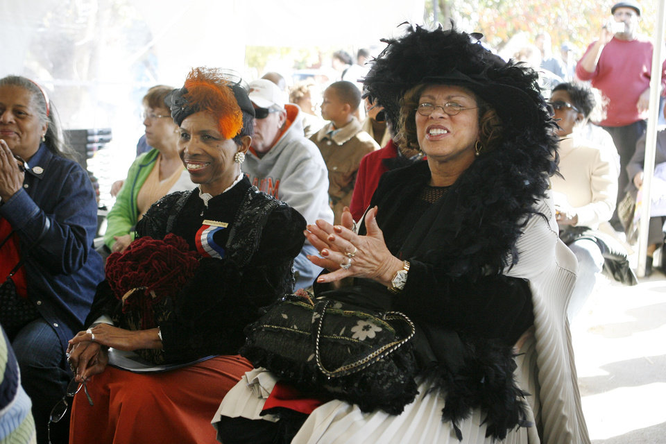 Photo - Evelyn Nephew with the Guthrie City Council, and Lola King, Education Officer with Tinker Air Force Base, watch a short play, one of several African American Statehood Events at E.B. McCable theatre, during the Centennial Day celebrations in Guthrie, OK, Thursday, Nov. 16, 2007. By Paul Hellstern / The Oklahoman