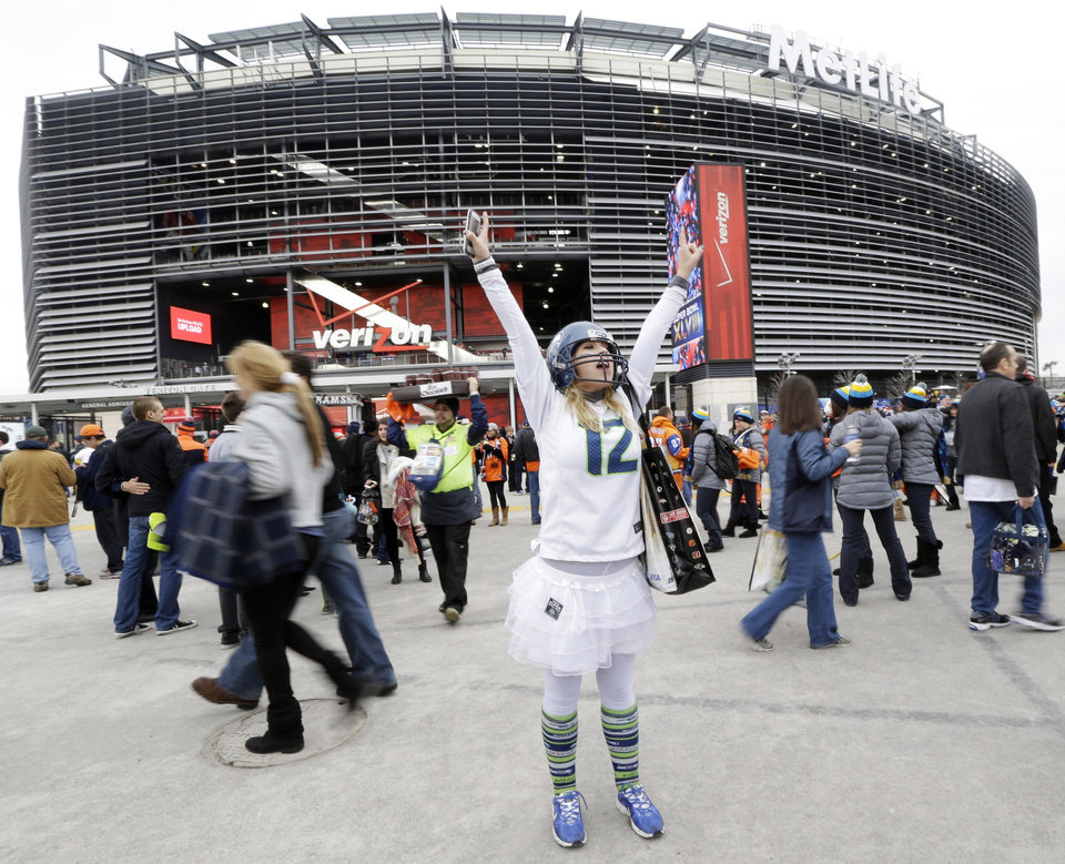 Photo - Lacey Surprenat of Seattle cheers outside MetLife Stadium before the NFL Super Bowl XLVIII football game Sunday, Feb. 2, 2014, in East Rutherford, N.J. (AP Photo/Julio Cortez)