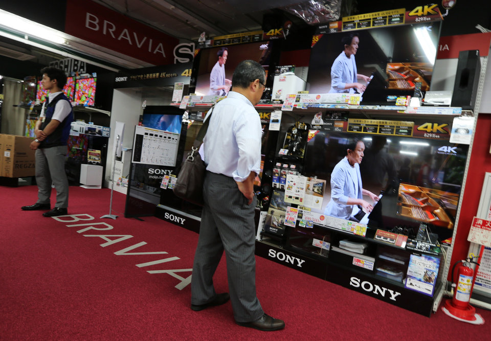 Photo - A customer checks the Sony's high-definition LCD televisions