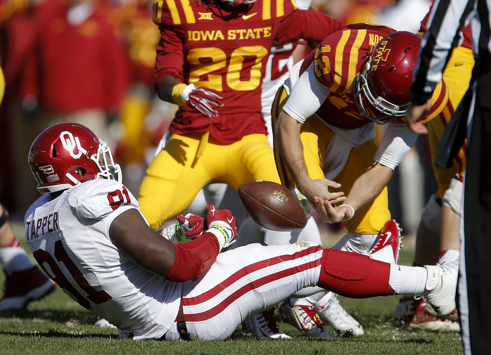 Photo - Oklahoma's Charles Tapper (91) strips the ball from Iowa State's Sam B. Richardson (12) as he sacks him during a college football game between the University of Oklahoma Sooners (OU) and the Iowa State Cyclones (ISU) at Jack Trice Stadium in Ames, Iowa, Saturday, Nov. 1, 2014. Photo by Bryan Terry, The Oklahoman