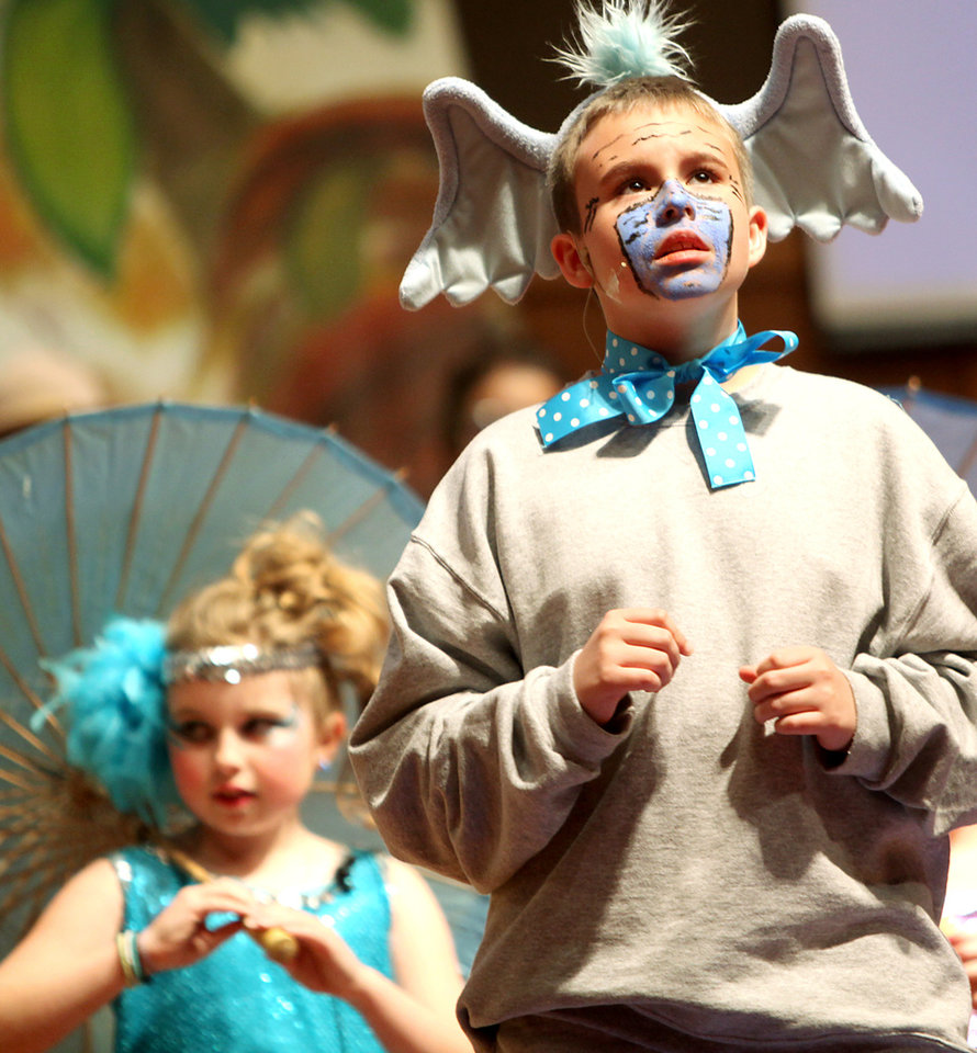 Vinnie McLain, a fifth-grader at St. Mary\'s plays Horton (foreground) while Abby Zimmerman, a fourth-grader, plays a bird girl (background) during a production of