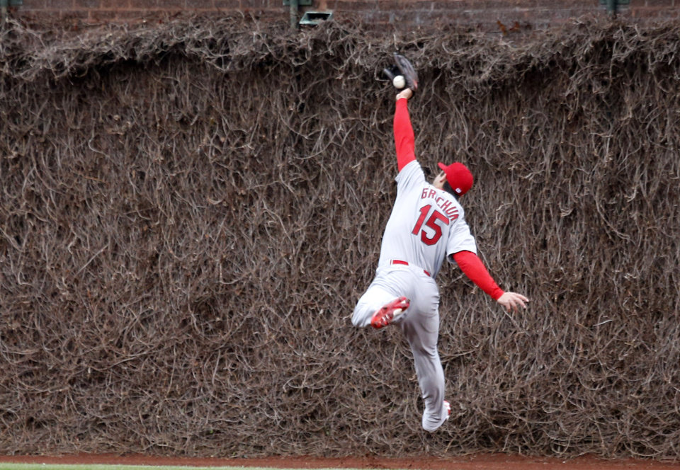 Photo - St. Louis Cardinals fielder Randal Grichuk is unable to catch a deep fly ball from Chicago Cubs' Welington Castillo during the second inning of a baseball game Friday, May 2, 2014, in Chicago. (AP Photo/Charles Rex Arbogast)