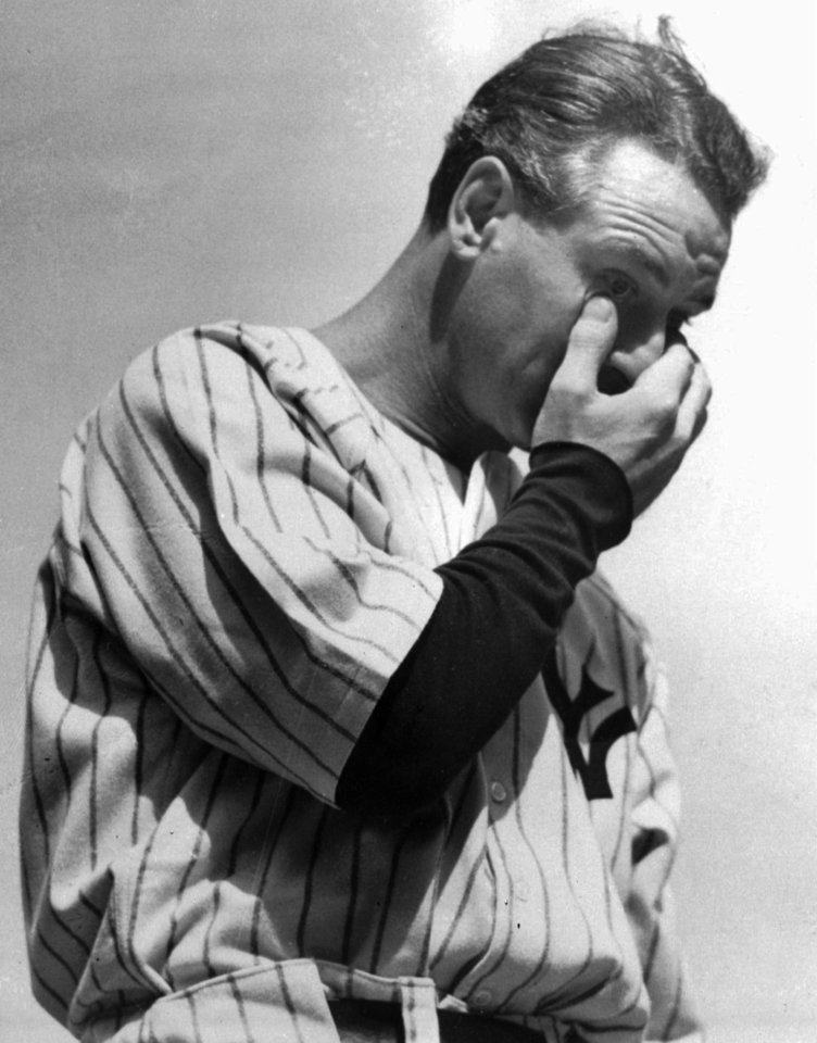 Photo - Yankees first baseman Lou Gehrig wipes a tear from his eye while giving his famous speech on July 4, 1939. Gehrig died two years later from what is now popularly known as