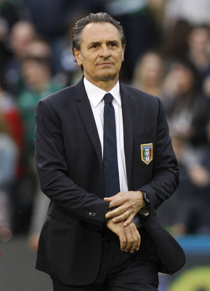 Photo - Italy's head coach Cesare Prandelli arrives at the dugout before the start of their international friendly soccer match against Republic of Ireland at Craven Cottage, London, Saturday, May 31, 2014. (AP Photo/Sang Tan)