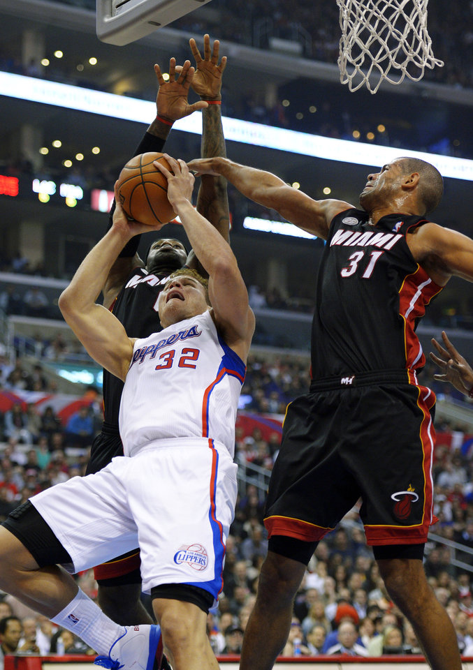 Los Angeles Clippers forward Blake Griffin (32) shoots as Miami Heat forward LeBron James, left, and forward Shane Battier defend during the first half of their NBA basketball game, Wednesday, Nov. 14, 2012, in Los Angeles. (AP Photo/Mark J. Terrill)
