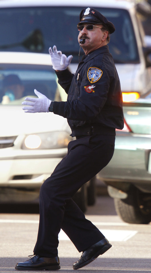 Police office Tony Lepore directs traffic in Providence, R.I. He is know as the dancing cop because of his energetic and rhythmic style of moving vehicles through an intersection. AP photo